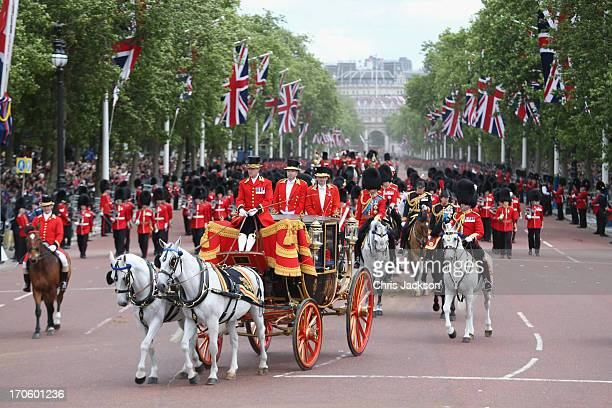 Queen Elizabeth II makes her way back towards Buckingham Palace during the annual Trooping the Colour Ceremony on June 15 2013 in London England...