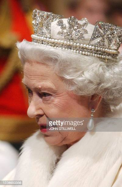 Queen Elizabeth II makes her way from the Sovereign's entrance, up the stairs towards the Norman porch prior to making the Queen's Speech, 26...