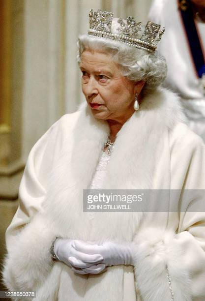 Queen Elizabeth II makes her way from the Sovereign's entrance, up the stairs towards the Norman porch, ahead of making the Queen s Speech, 26...
