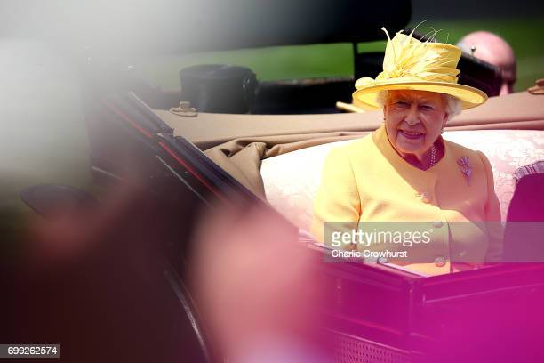 Queen Elizabeth II makes her way to the grandstand during day 2 of Royal Ascot at Ascot Racecourse on June 21 2017 in Ascot England