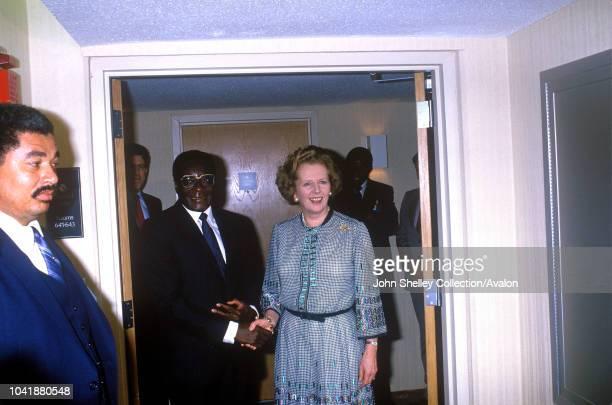 Queen Elizabeth II Margaret Thatcher and Robert Mugabe Commonwealth Heads of Government Meeting 1985 Nassau The Bahamas Margaret Thatcher UK Prime...
