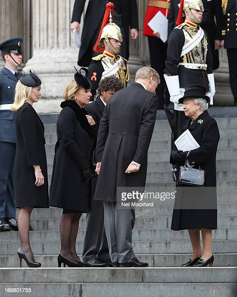 Queen Elizabeth II Mark Thatcher Sarah Thatcher Carol Thatcher and Marco Grass seen attending Baroness Thatcher's Funeral at St Paul's Cathedral on...