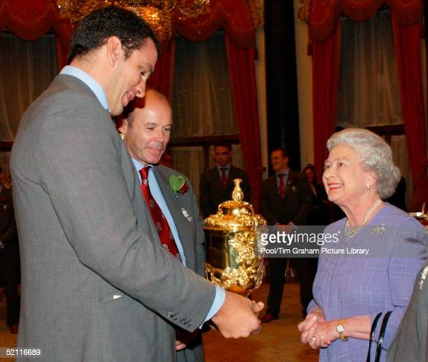 Queen Elizabeth II Meeting England Rugby Captain Martin Johnson And Coach Clive Woodward At A Reception For The World Cup Winning Team Held In The...