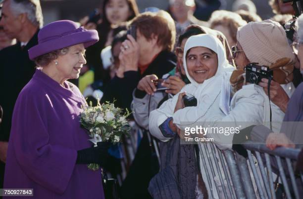 Queen Elizabeth II meeting members of the public during a walkabout in Winchester Hampshire 19th November 1993