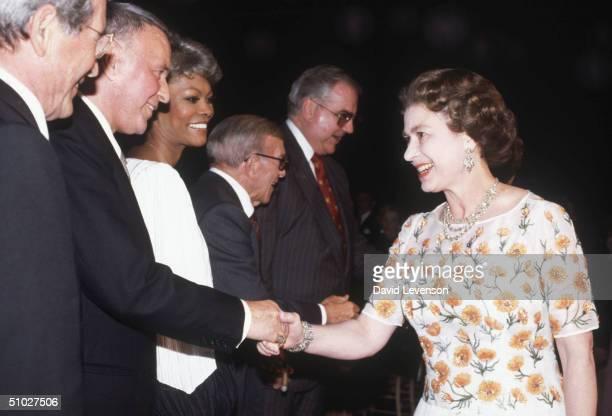 Queen Elizabeth II meeting singer Frank Sinatra at the studios of Twentieth Century Fox on February 27, 1983 in Long Beach, California, USA. From the...