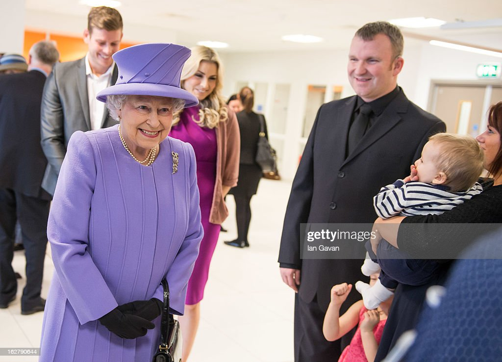 Queen Elizabeth II meets 7/7 survivor Bruce Lait and his family during her tour to open the new Royal London Hospital building and the new National Centre for Bowel Research and Surgical Innovation on February 27, 2013 in London, England.