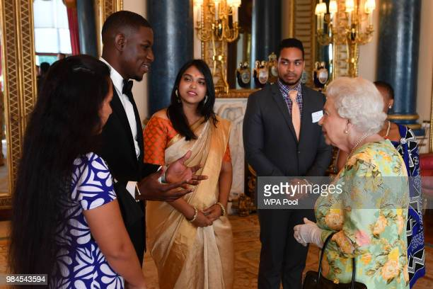 Queen Elizabeth II meets a group of Queen's Young Leaders at the Queen's Young Leaders Awards Ceremony at Buckingham Palace on June 26 2018 in London...