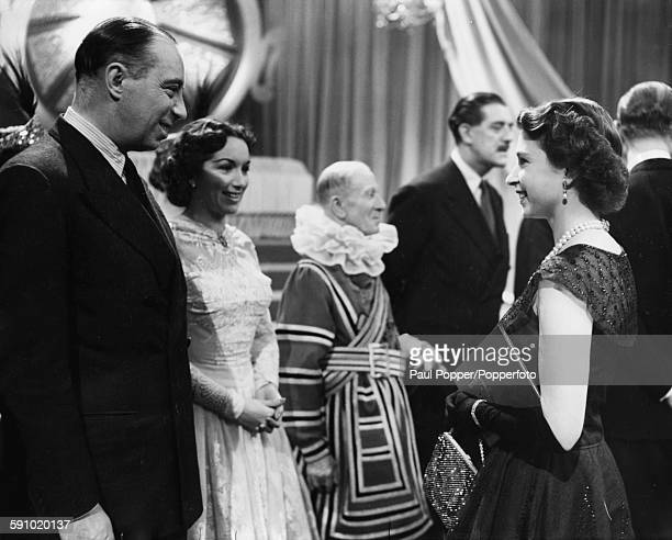 Queen Elizabeth II meets actors Bill Fraser and Pat Kirkwood during her tour of the BBC television Studios at Lime Grove in West London on October...