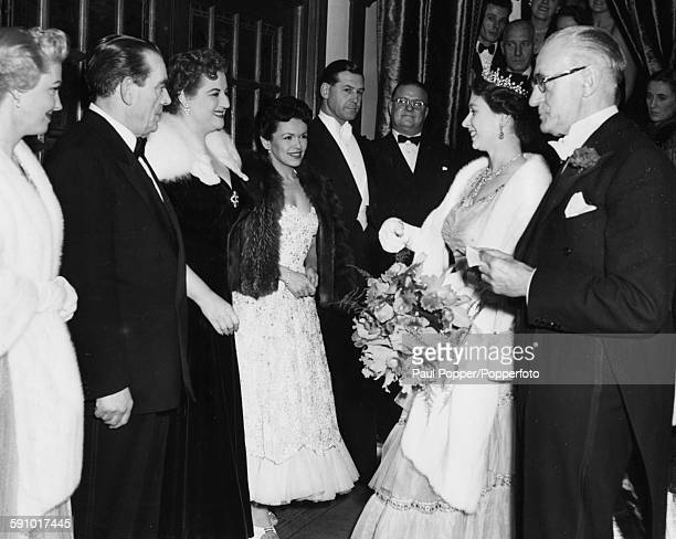Queen Elizabeth II meets actress Anne Shelton who is standing next to Eve Boswell and Jimmy James after watching the Royal Variety Performance of...