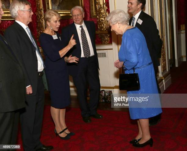 Queen Elizabeth II meets actress Dame Helen Mirren the Dramatic Arts reception at Buckingham Palace on February 17 2014 in London England