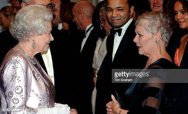 Queen Elizabeth II meets actress Dame Judi Dench at the premiere of the 21st Bond film 'Casino Royale' at the Odeon cinema in Leicester Square.