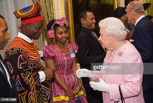 Queen Elizabeth II meets Africa Regional Winner of the Commonwealth Youth Awards Achaleke Christian Leke and Caribbean Regional Winner Shamoy Hajare...