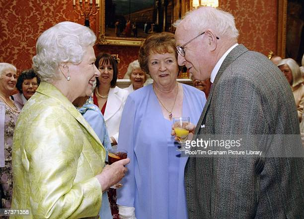 Queen Elizabeth II meets Allan Garrioch and his wife Helen at an 80th birthday lunch April 19, 2006 in London, England. The lunch is held by The...