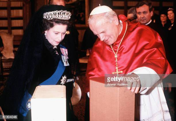 Queen Elizabeth II meets and exchanges gifts with Pope Paul II for the first time in the Vatican, October 17 in Vatican City State.