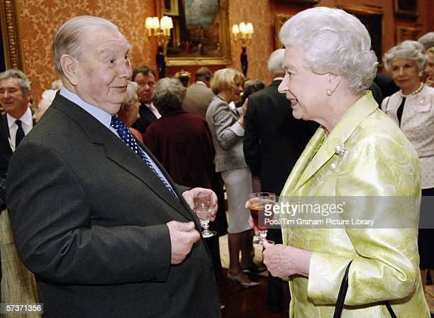 Queen Elizabeth II meets Bertie Hucklesby at an 80th birthday lunch April 19, 2006 in London, England. The lunch is held by The Queen at Buckingham...