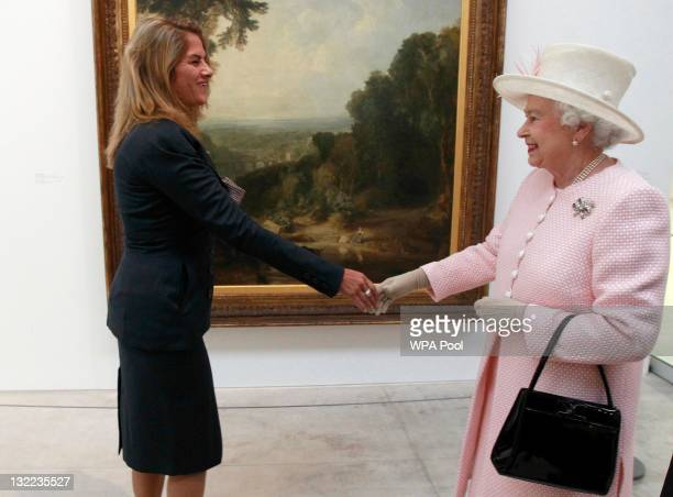 Queen Elizabeth II meets British artist Tracey Emin in front of JMW Turner's 'Crossing the Brook' while visiting the Turner Contemporary Gallery on...