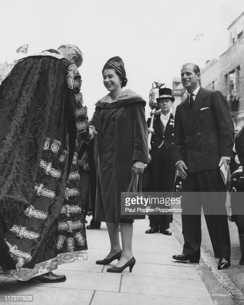 Queen Elizabeth II meets British Prime Minister Harold Macmillan Chancellor of Oxford University outside the Clarendon Building during a visit to...