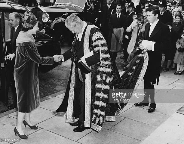 Queen Elizabeth II meets British Prime Minister Harold Macmillan , Chancellor of Oxford University, outside the Clarendon Building during a visit to...
