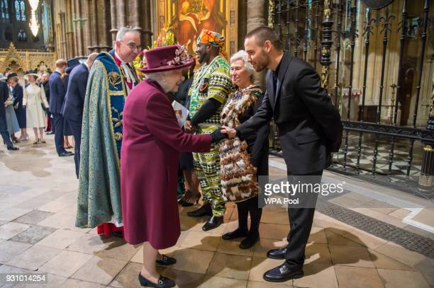Queen Elizabeth II meets British singer Liam Payne after the Commonwealth Service at Westminster Abbey on March 12 2018 in London England Organised...