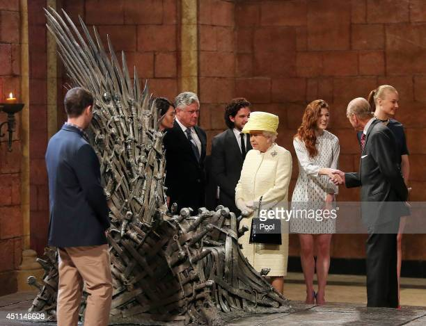 Queen Elizabeth II meets cast members of the HBO TV series 'Game of Thrones' Lena Headey and Conleth Hill while Prince Philip, Duke of Edinburgh...