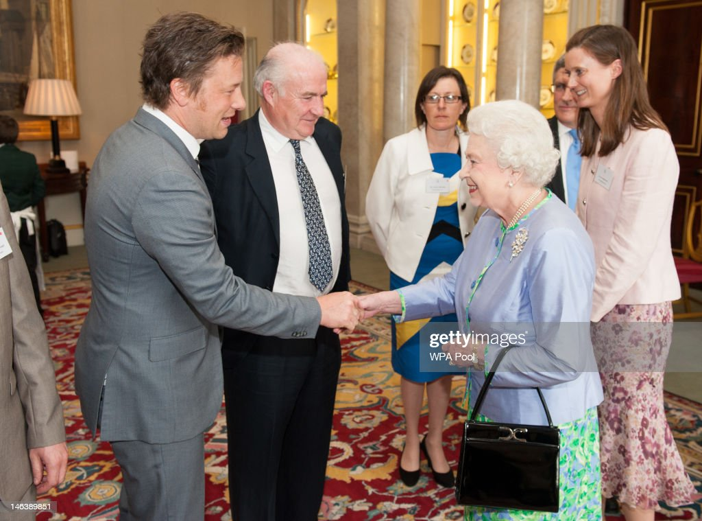 Queen Elizabeth II meets chefs Jamie Oliver (L) and Rick Stein (2L) at a reception at Buckingham Palace on June 15, 21012 in London, England. Queen Elizabeth II and the Duchess of Cornwall met winners of the 'Cook for the Queen' competition, who created the menu served at a reception at Buckingham Palace.