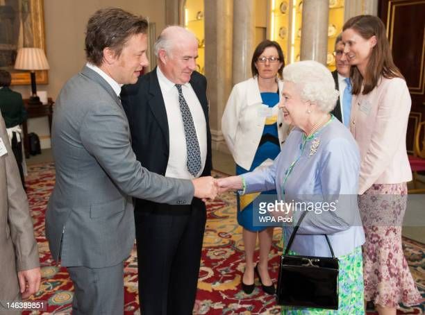 Queen Elizabeth II meets chefs Jamie Oliver and Rick Stein at a reception at Buckingham Palace on June 15 21012 in London England Queen Elizabeth II...