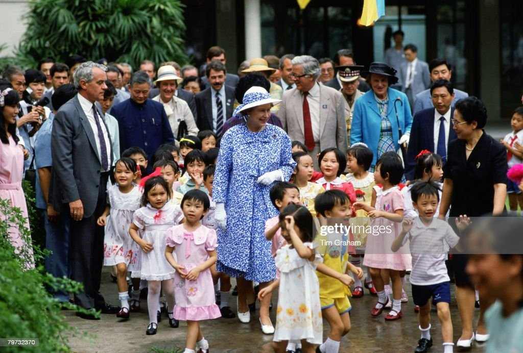 Queen Elizabeth II meets children at the Children's Palace in Canton during a visit to China