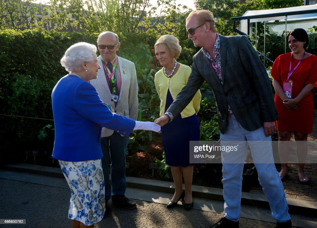 Queen Elizabeth II meets Chris Evans and Mary Berry at the BBC Radio 2 Garden at the RHS Chelsea Flower Show press day at Royal Hospital Chelsea on May 22, 2017 in London, England. The prestigious Chelsea Flower Show, held annually since 1913 in the Royal Hospital Chelsea grounds, is open to the public from the 23rd to the 27th of May, 2017.