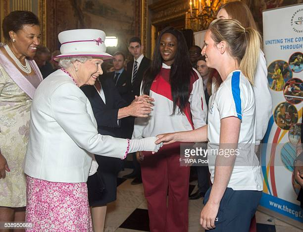 Queen Elizabeth II meets Commonwealth Games Hockey athlete Ali Bell at Marlborough House as she launches Commonwealth Hub which brings Commonwealth...