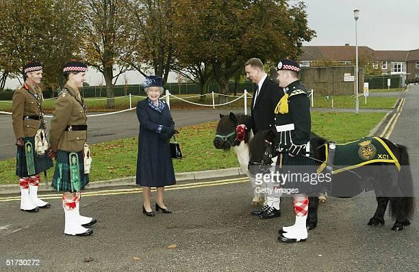 HRH Queen Elizabeth II meets Cruachan the Shetland Pony mascot and its companion Shajaadat at Howe Barracks in Canterbury November 9 2004 in Kent...