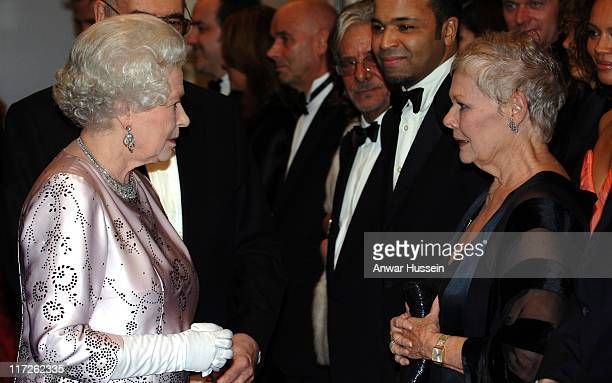 HM Queen Elizabeth II meets Dame Judi Dench at the Royal Premiere for the 21st Bond film Casino Royale at the Odeon Leicester Square on November 14...