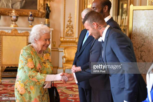 Queen Elizabeth II meets David Beckham at Buckingham Palace on June 26 2018 in London England The Queen's Young Leaders Programme now in its fourth...