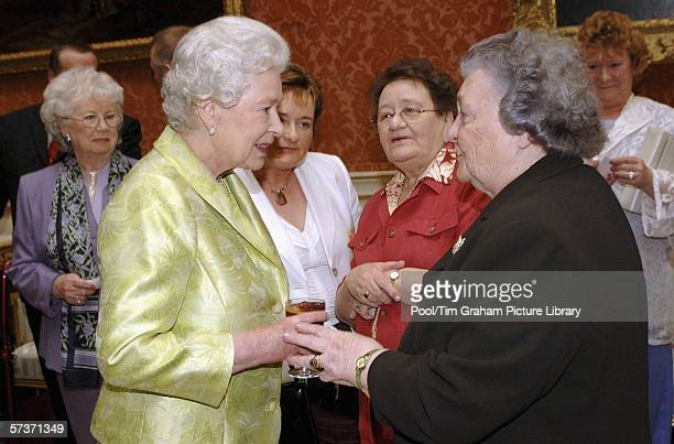 Queen Elizabeth II meets Doreen O'Leary at an 80th birthday lunch April 19, 2006 in London, England. The lunch is held by The Queen at Buckingham...