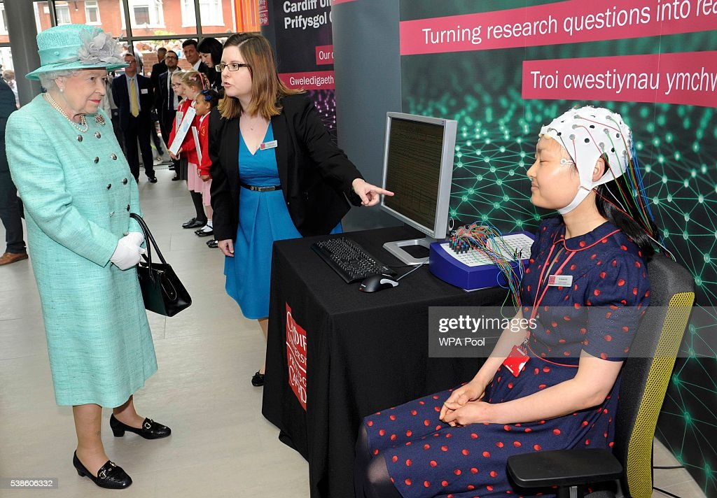 Queen Elizabeth II (L) meets Dr Grace Xia at the opening of the Cardiff University Brain Research Imaging Centre on June 7, 2016 in Cardiff, Wales.