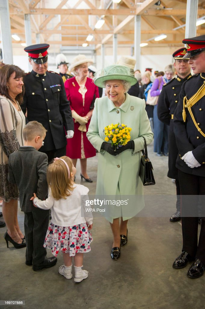 Queen Elizabeth II meets family of serving personnel during a visit to The King's Troop Royal Horse Artillery unit at Woolwich Barracks on May 31, 2013 in Woolwich, England.