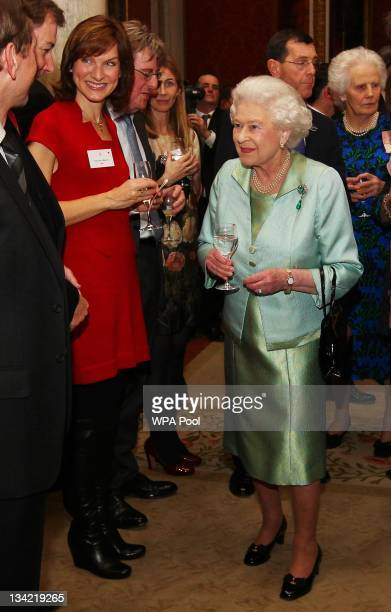 Queen Elizabeth II meets Fiona Bruce during a reception held for members of the media to mark next years Diamond Jubilee at Buckingham Palace on...