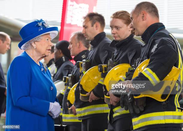 Queen Elizabeth II meets firefighters during a visit to the Westway Sports Centre which is providing temporary shelter for those who have been made...