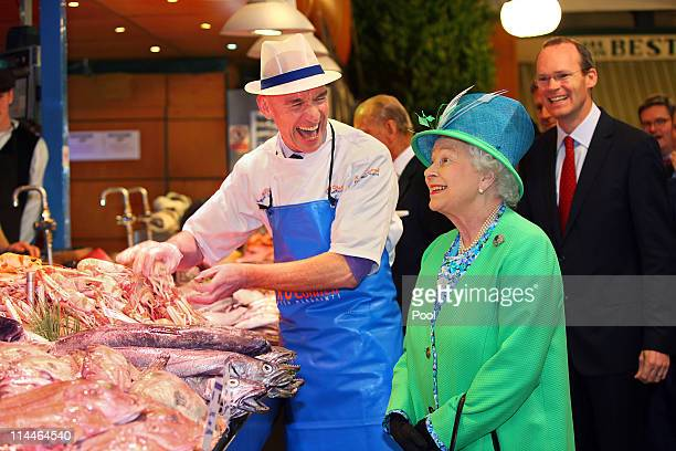 Queen Elizabeth II meets Fish Monger Pat O'Connell at the English Market on May 20 2011 in Cork Ireland Queen Elizabeth II and Prince Philip Duke of...