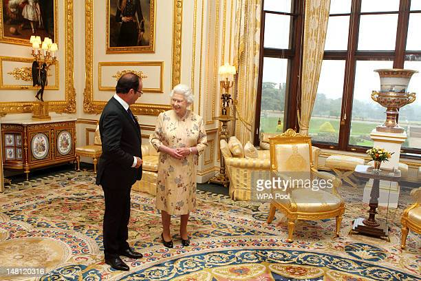 Queen Elizabeth II meets French President Francois Hollande at Windsor Castle, on July 10, 2012 in Windsor, England. This is the French President's...