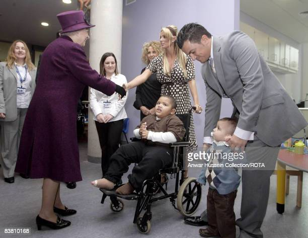 HM Queen Elizabeth II meets glamour model Jordan her son Harvey her husband singer Peter Andre and the couple's son Junior as she opens The Richard...