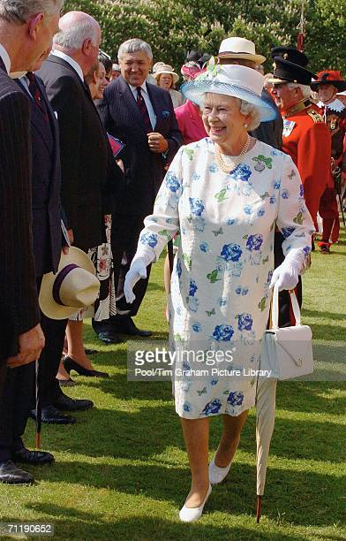 Queen Elizabeth II meets Grenadier Guards and their families gathered to mark the 350th anniversary of the Grenadier Guards on the lawns of...