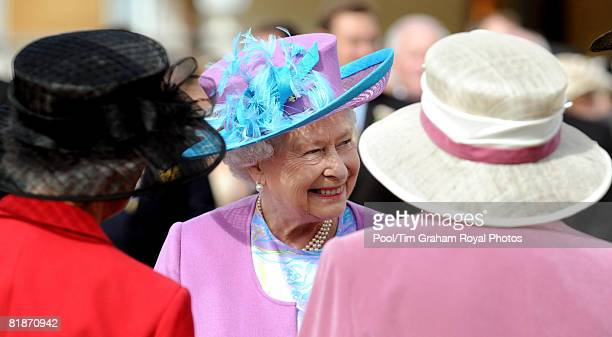 Queen Elizabeth II meets guests as she hosts a garden party in the grounds of Buckingham Palace on July 8, 2008 in London, England.