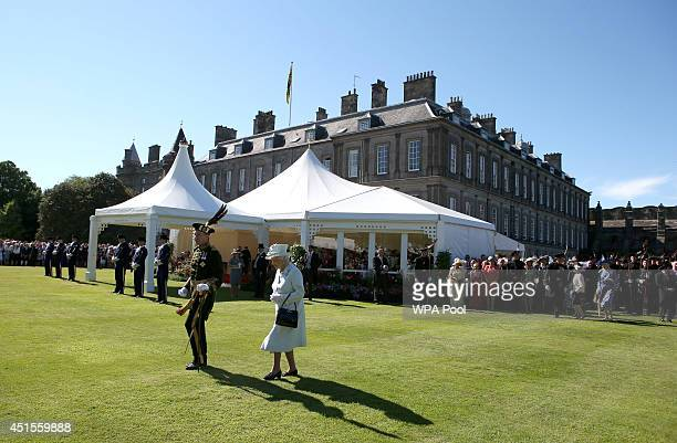 Queen Elizabeth II meets guests at a Garden Party at the Palace of Holyroodhouse on July 1 2014 in Edinburgh Scotland