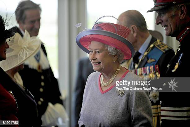 Queen Elizabeth II meets guests at RAF Fairford, during a presentation of new colours on the RAF's 90th Birthday, on July 11, 2008 in...