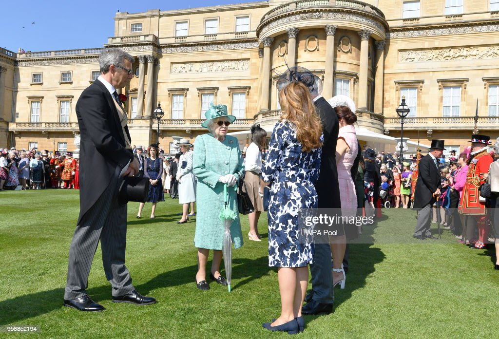 Queen Elizabeth II meets guests during a garden party at Buckingham Palace on May 15, 2018 in London, England.