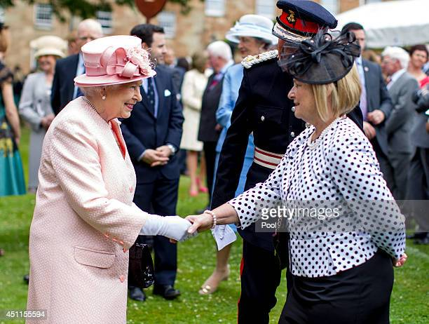 Queen Elizabeth II meets guests during a garden party held at Hillsborough Castle on day two of their visit on June 24 2014 in Belfast Northern...