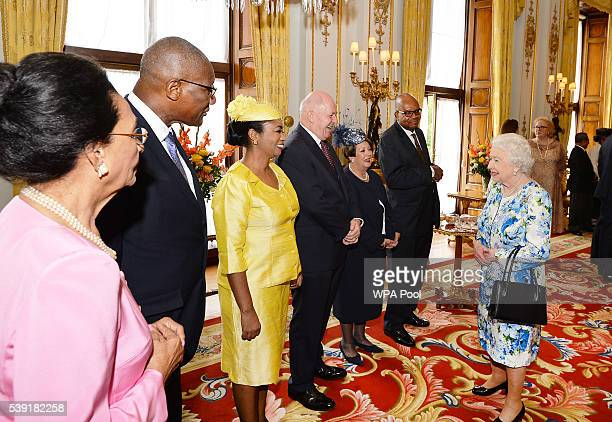 Queen Elizabeth II meets guests during a reception during a reception ahead of a lunch at Buckingham Palace on June 10, 2016 in London, United...