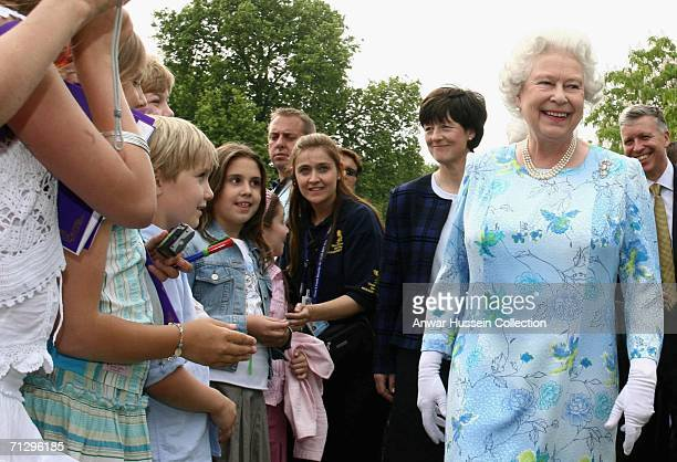 Queen Elizabeth II meets guests during the Children's Garden Party at Buckingham Palace on June 25 2006 in London England