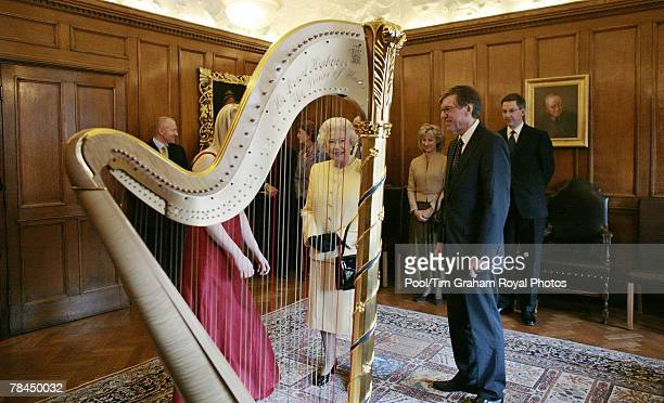 Queen Elizabeth II meets harpist Clare Jones during a visit to the Royal Academy of Music on December 13, 2007 in London, England.