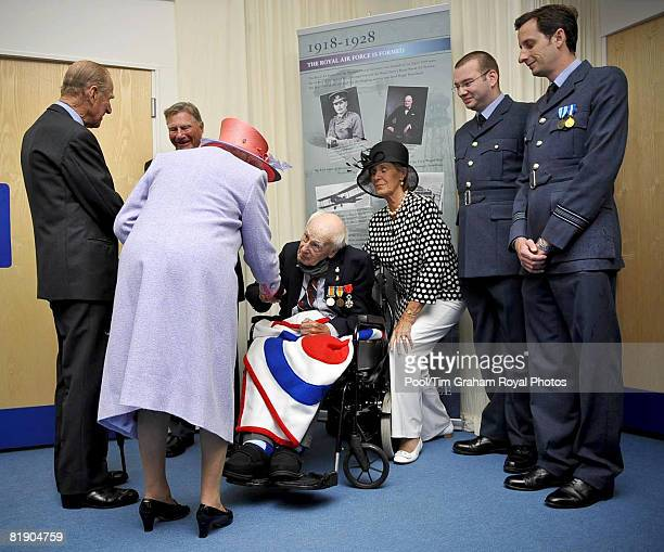 Queen Elizabeth II meets Henry Allingham, aged 112, the oldest surviving World War I veteran at RAF Fairford where the Queen presented new Colours at...